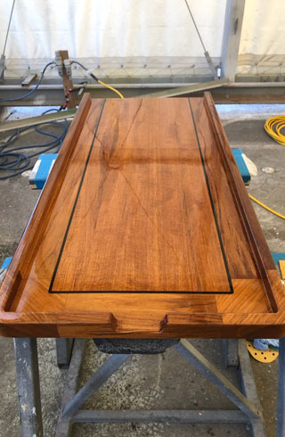 shipwrights and fabrication teak table with epoxy inlay